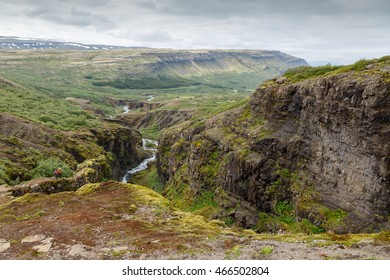 Looking down in the valley from the highest waterfall of Iceland Glymur