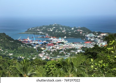 Looking down the valley towards the city of Castries, St Lucia. Shows the town & the port with a Cruise ship docked.
