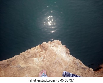 Looking down when standing at the edge of cliff