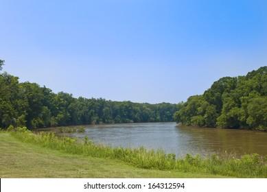 Looking downstream from the banks of the muddy Savannah River between Georgia and South Carolina.