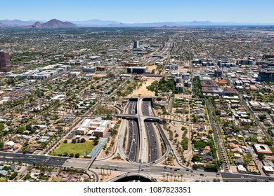 Looking east from above Interstate 10 at the Deck Park Tunnel and the cities of Phoenix, Scottsdale and Tempe, Arizona