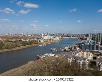 Looking east along the River Thames from Wandsworth Park towards the city on sunny march afternoon