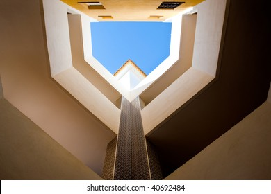 Looking up in a European style courtyard with natural light.