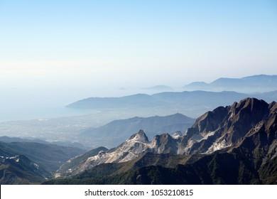 Looking at the far vanishing sea from Mount Tambura, Alpi Apuane, Tuscany, Italy.