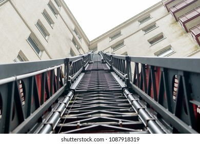 Looking up a Fireman Ladder, Firefighter Truck extendable Ladder next to Tower Block, England 2018 shallow depth of field horizontal perspective photography