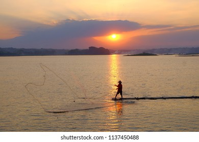 looking for fish at sunset