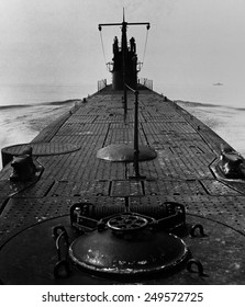 Looking forward along the deck of U.S. submarine during World War 2. August 1943.