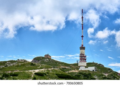 Looking up at german chapel Maria am Stein and the radio tower on top of Mount Dobratsch in the austrian Alps near Villach