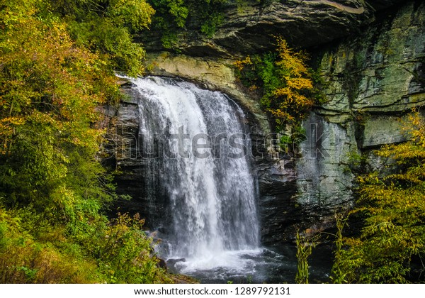 Looking Glass Falls, at 60 feet., is located in the Pisgah National Forest in North Carolina near Brevard. The sheer force of the water plummeting over the spectacular rock cliffs, is amazing.