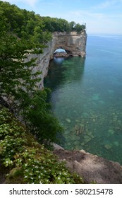 Looking at Grand Portal Point, a popular spot along the Pictured Rocks National Lakeshore in the Upper Peninsula of Michigan. Lake Superior is calm and you can see the rocks underwater.