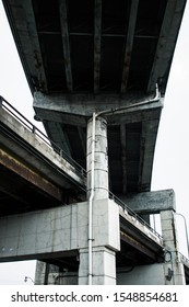 Looking up at a highway overpass in the city
