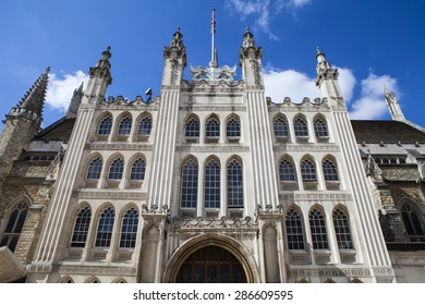 Looking up at the impressive facade of Guildhall in London.
