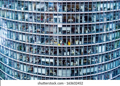 looking inside many offices of a skyscraper