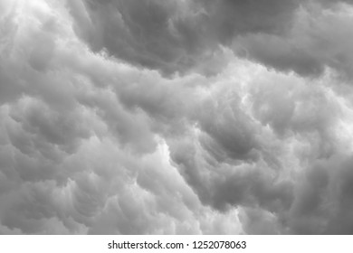 Looking up into brooding grey cumulus storm clouds