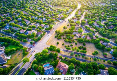 Looking into golden sunset Modern homes and houses in suburb. High aerial view above thousands of homes north of Austin , Texas in Round Rock Suburbia sunset colors of new development neighborhood