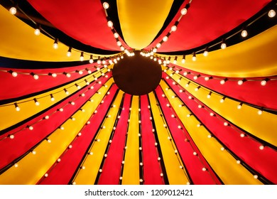 Looking up into the roof of a small circus tent
