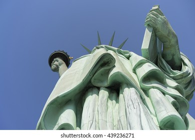 Looking up at Lady Liberty holding torch and tablet