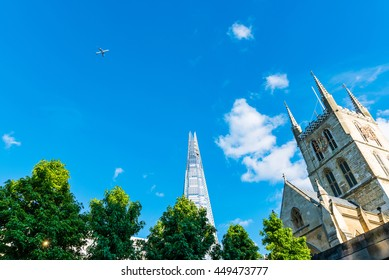 Looking up in London with small plane in the sky
