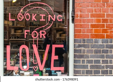 Looking for love written in pink ink on a shop window in Shoreditch (London)