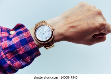 looking at luxury watch on hand check the time.concept for managing time organization working,punctuality,appointment.fashionable wearing stylish