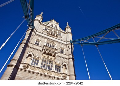 Looking up at the magnificent architecture of Tower Bridge in London.
