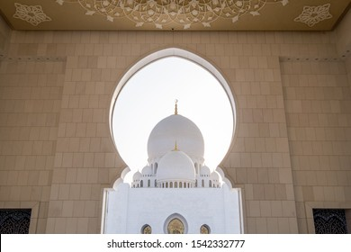 Looking at main dome of Sheikh Zayed Grand Mosque Abu Dhabi at sunset blue hour