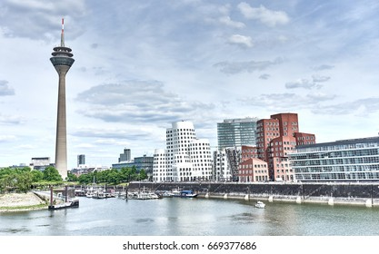 Looking at Media Harbor at Rhine-River in Dusseldorf in Germany / Media Harbor with Rhine-Tower and famous buildings from Frank Gehry / Cityscapes of Germany