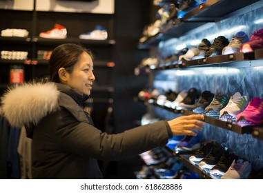 Looking at Merchandise. Shopping. Shoes.