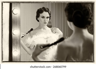 looking mirror flapper Woman vintage dress. White and black sepia color styling old photo. cold finger waves hairstyle. Retro portrait beautiful Great Gatsby Vogue fashion old style 1920