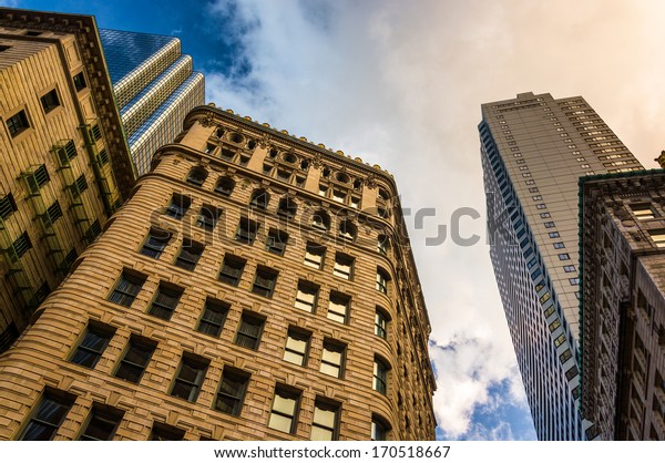 Looking up at modern buildings and old architecture in Boston, Massachusetts.