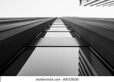 looking up at a modern urban city skyscraper
