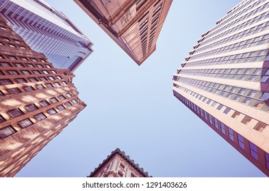 Looking up at New York buildings, color toned picture, USA.