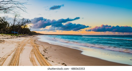 Looking north along the beach on North Stradbroke Island at Sunset in Queensland, Australia