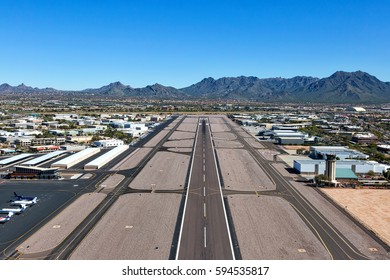 Looking northeast from above the runway in Scottsdale, Arizona at the McDowell Mountains