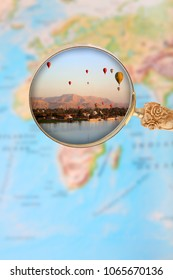 Looking in on hot air balloons over Luxor Egypt at sunrise through a loop or magnifying glass