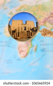 Looking in on Karnak Temple Egypt with a magnifying glass or loop on an atlas map of Africa and the world