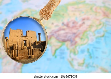 Looking in on Karnak temple in Egypt, Africa with a magnifying glass over  a world map