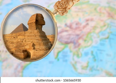 Looking in on The Sphinx and Pyramid at Giza with a magnifying glass or loop over an atlas in Egypt, Africa