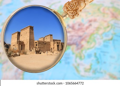 Looking in on the Temple of Philae in Egypt, Africa with a magnifying glass or loop over an atlas