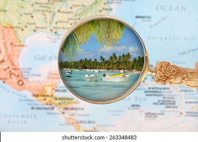 Looking in on a tropical beach with a blurred map of the Caribbean in the background