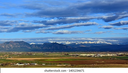 looking out at boulder's flat irons, rock creek farm open space, and the front range of colorado's rocky mountains from broomfield, colorado, on a lovely early morning spring day