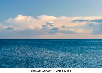 Looking out from Charlestown harbour wall to a blue hued abstract of sea and sky.