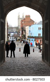 Looking out of the Entrance Gate to Windsor Castle onto a Cobbled street with a Church in the Background
