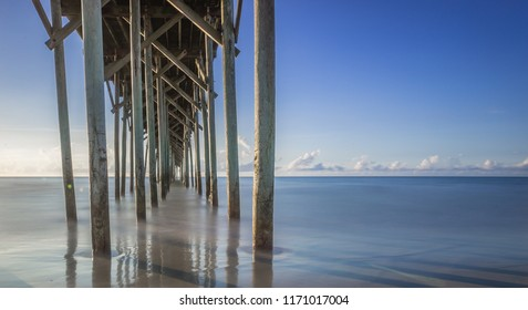 Looking out to horizon from under a pier