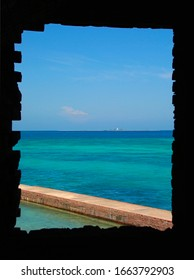 Looking out at loggerhead key through a brick window from fort jefferson on garden key at the dry tortugas national park