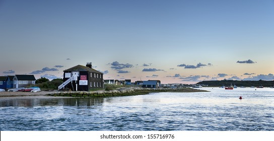 Looking out at Mudeford Spit and Hengistbury Head from the Quay at Mudeford near Christchurch in Dorset