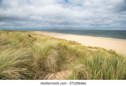 Looking out at the North Sea over the beach and sand dunes at Winterton on Sea on the Norfolk coast