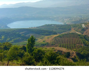 Looking out over the agricultural fields on the Golan Heights with Birkat Ram lake in the background