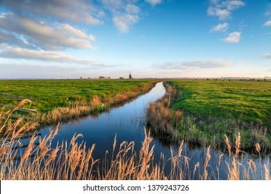 Looking out over Halvergate Marshes to Mutton's Mill near Great Yarmouth on the Norfolk Broads, also known as Halvergate Mill