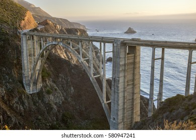 Looking out over the Pacific ocean at Bixby Bridge in Big Sur, California at sunset.